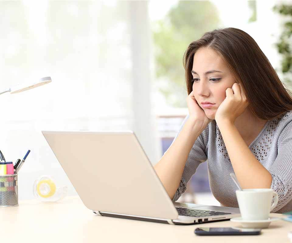 woman slow wifi connection at home covid